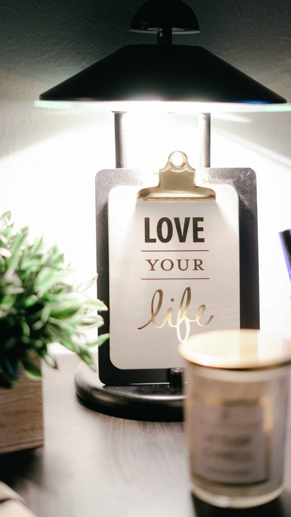clipboard with graphic words that say 'love your life'