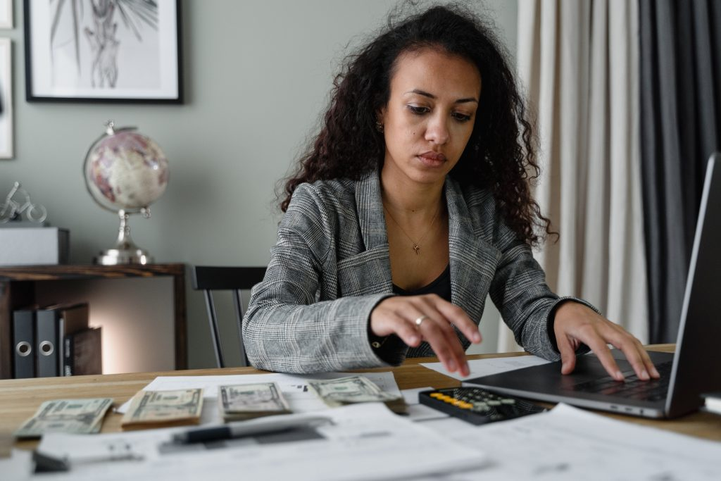 Woman sitting down to do her business accounting